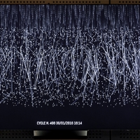 thousands of points of white light on a dark background, a visual representation of data on a computer screen