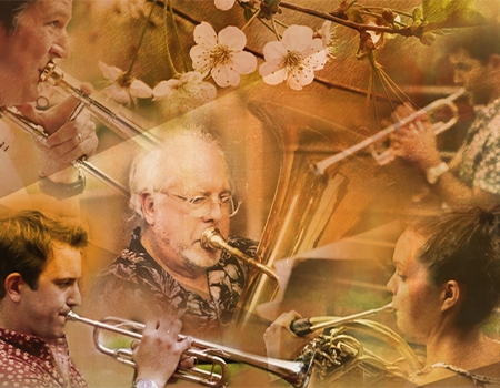 A kaleidescopic collage of images of five different horn players, a mix of men and women, young and old, is arrayed in overlapping layers with images of cherry blossoms, all suffused in yellow.