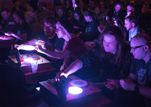image of audience at turntables in Kid Koala's Satellite Orchestra