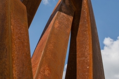 Weathered Steel spikes reaching up and out at different intervals and angles