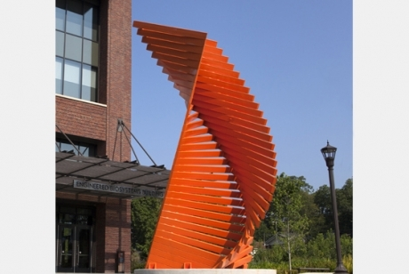bright orange steel boards stacked in a twisted tower