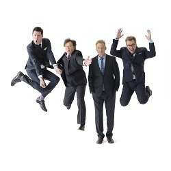 Cast members Ryan Stiles, Greg Proops, Jeff B. Davis, and Joel Murray are all smiles for the camera as three of them jump in the air..