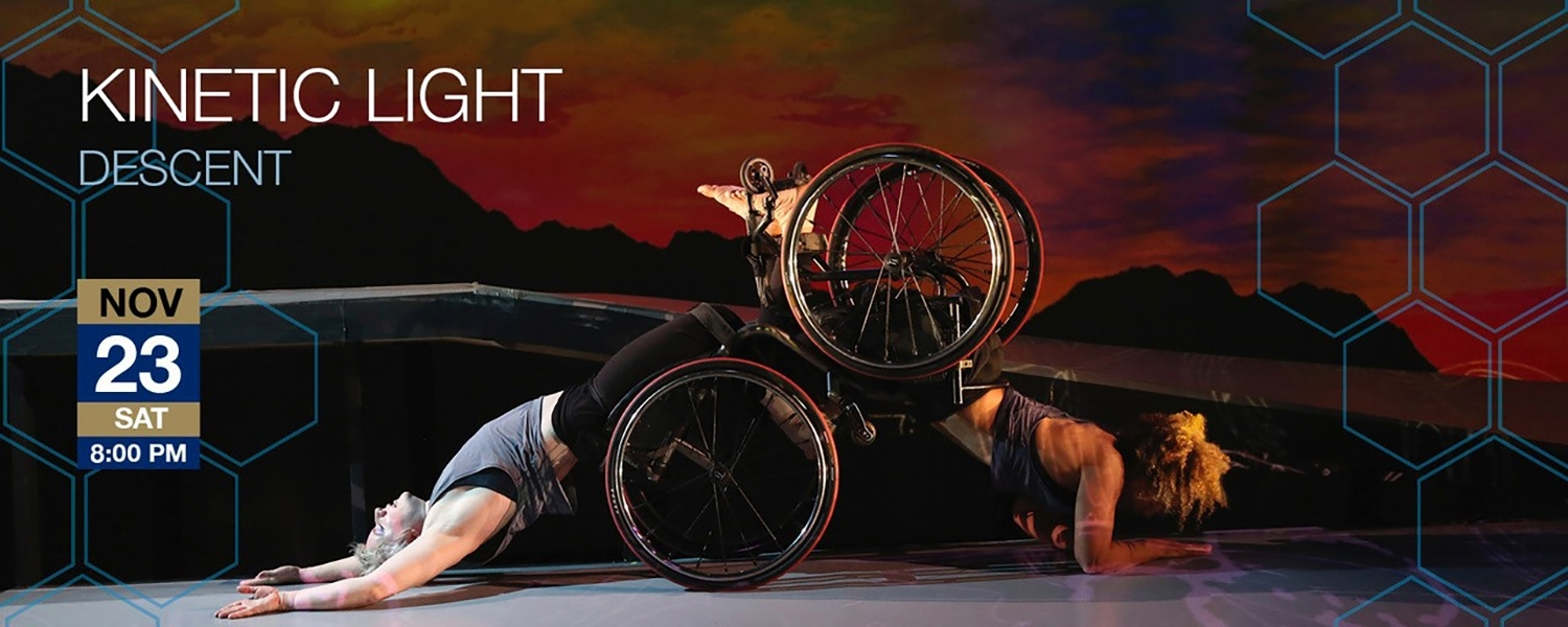 Performance information superimposed on photograph of dancers Laurel Lawson and Alice Sheppard, Laurel facing upwards on her back with her wheels resting on the ground, Alice facing away from Laurel, facing down, with her legs resting on Laurel's legs, her wheels up behind her, and her weight supported on her forearms.