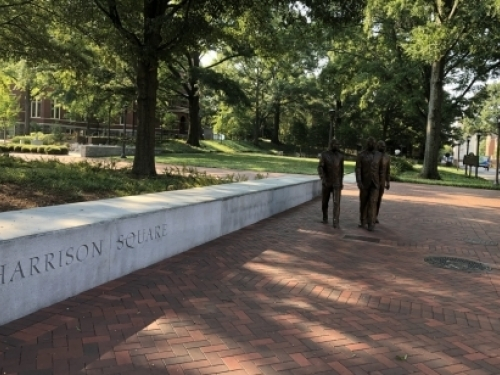 The figures of Ford Greene, Ralph Long Jr., and Lawrence Williams walking forward